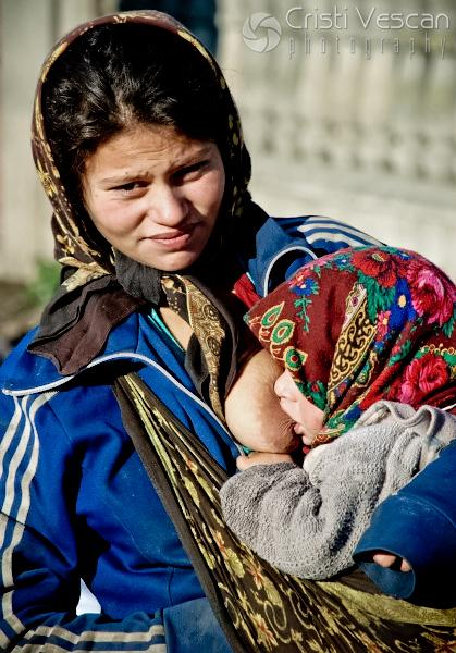poor gypsy mother with child